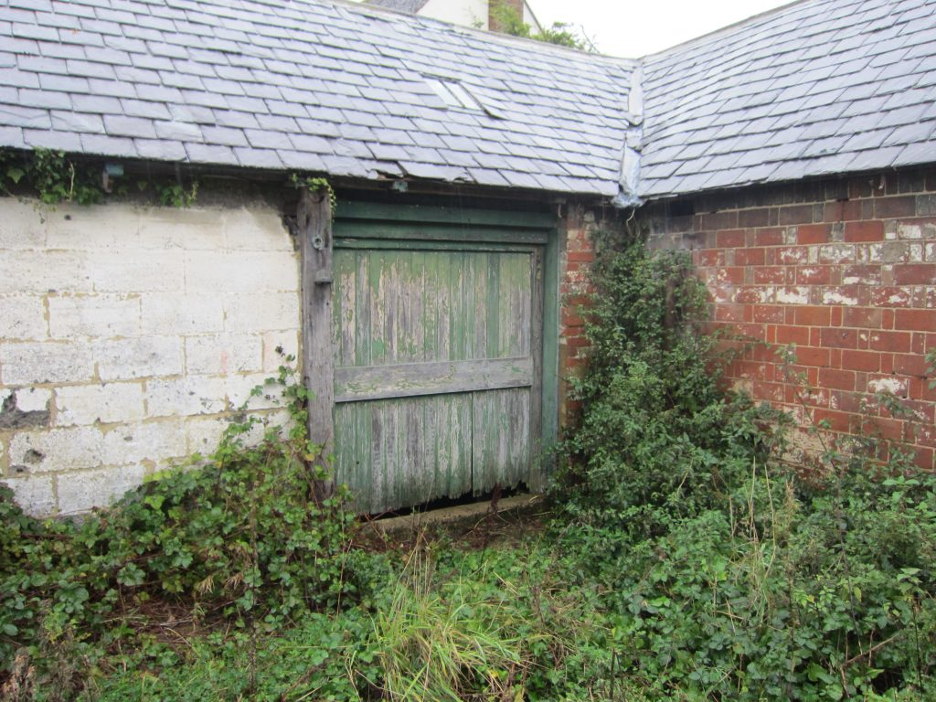 Entrance to a disused dairy shed