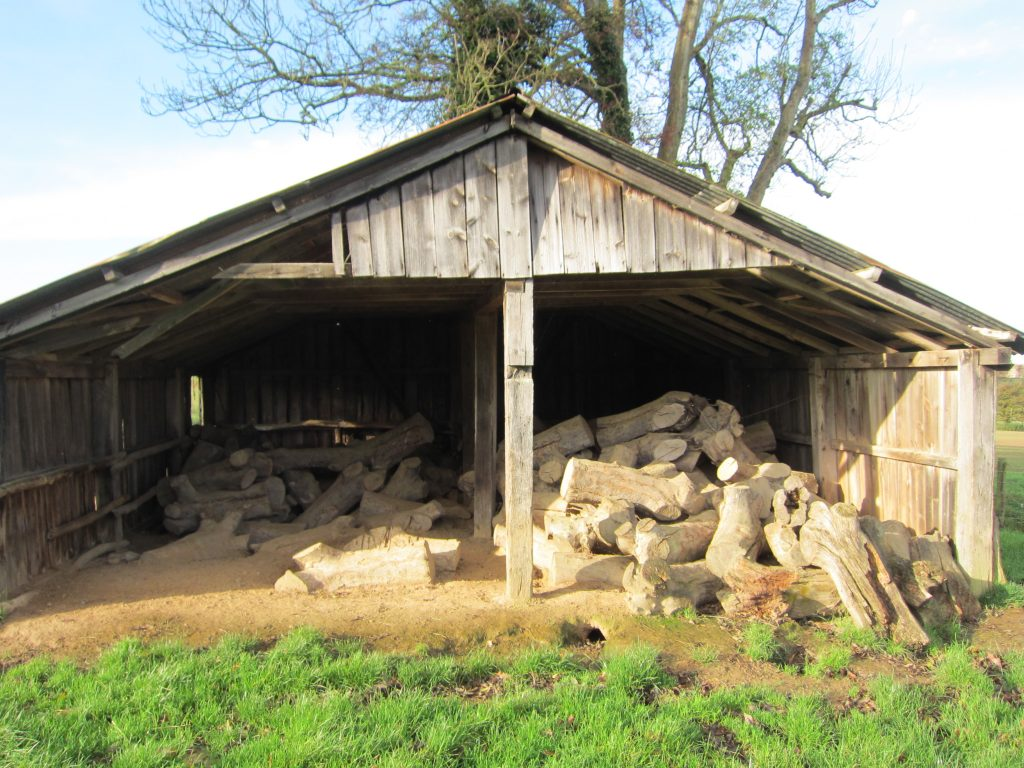 Wood store for a film set, East Sussex